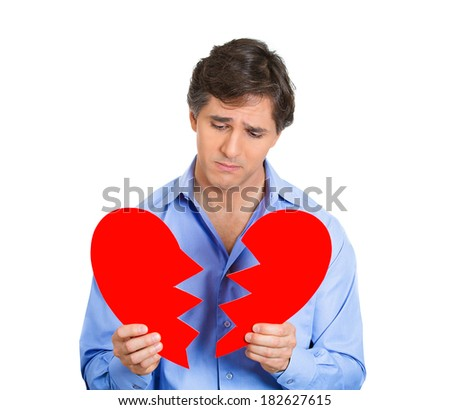 Closeup portrait young, troubled, sad, looking depressed man, guy holding broken heart in hands isolated white background. Negative human emotion, facial expressions, feelings, attitude, life reaction