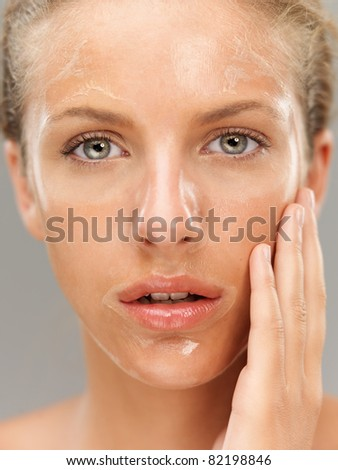 closeup portrait young woman with facial mask