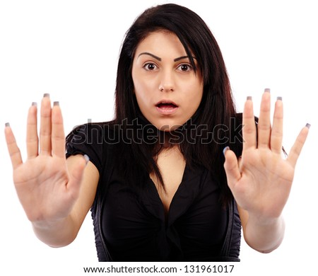 Closeup pose of a terrified young woman, isolated on white background