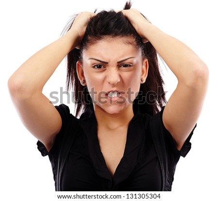 Closeup pose of an angry businesswoman pulling her her, isolated on white background
