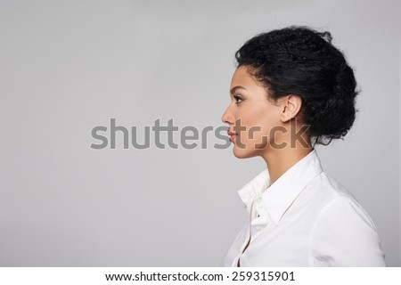 Closeup profile of confident business woman looking forward isolated on gray background