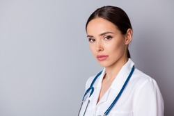 Closeup profile photo of attractive serious family doc not smiling experienced professional listen patient focused wear medical uniform lab coat stethoscope isolated grey background