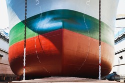 Closeup Prow of a ship, Draft scale on bow of large ship during moored in floating dry dock yard.