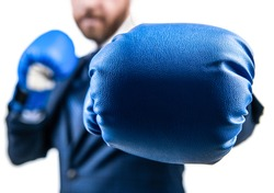 closeup punch of cropped businessman man in boxing gloves ready for corporate business battle, selective focus, knockout.