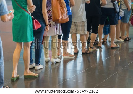 Closeup Queue of Asian people waiting at boarding gate at airport