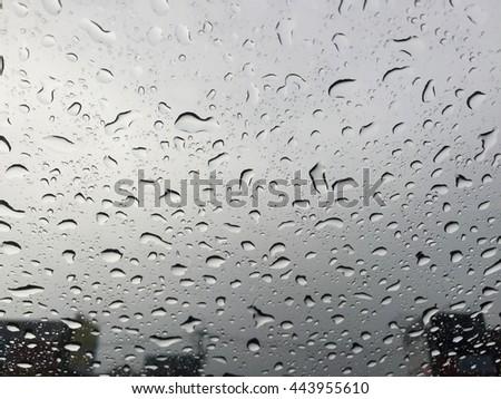 Closeup rain on window, When feeling blue in raining day on window #443955610