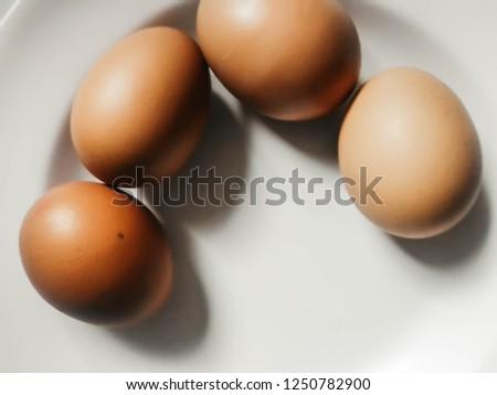 closeup raw brown eggs on dish #1250782900