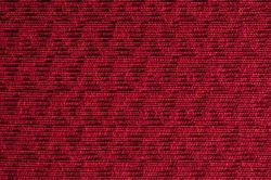 Closeup red color fabric sample texture backdrop.Red,burgundy,maroon colors fabric strip line pattern design,upholstery,textile for decoration interior design or abstract background.