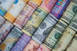 Closeup rolled of variety banknote around the world. Exchange rate and Forex investment concept.-Image.