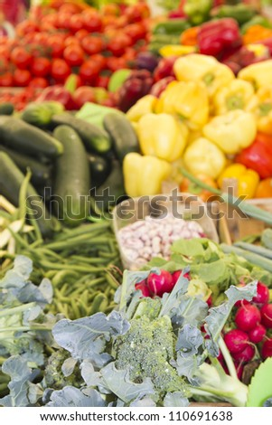 Closeup-selective focus of fresh organic vegetables on sunny Mediterranean market
