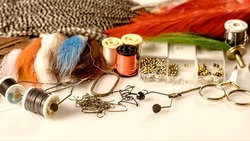 closeup set of different accessories for knitting flies for fly fishing
