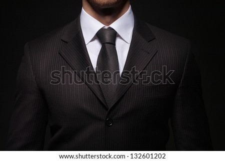 closeup shoot of businessman on dark background