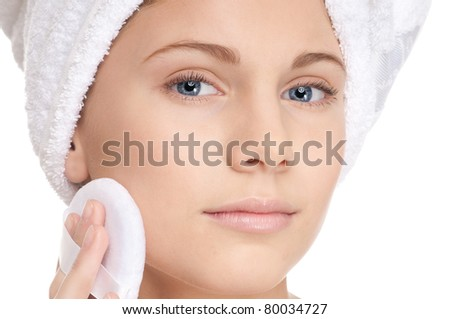 Closeup shoot of young beautiful woman with perfect skin apply cosmetic sponge