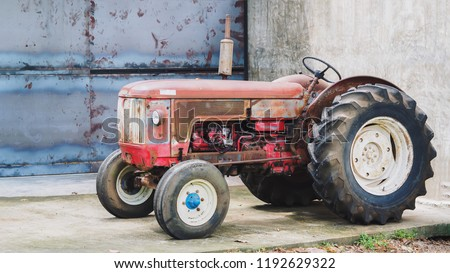 Closeup Shot of A Beautiful Red Vintage Tractor or Tracktor, Farm  / Agricultural Vehicle