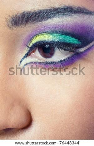Closeup shot of a beautiful young woman's eye with colorful makeup