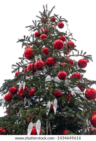 closeup shot of a big christmas tree with red baubles in white back #1434649616