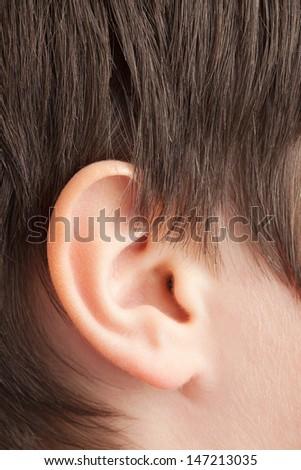 Closeup shot of a human ear, teenager (13 years old) Caucasian boy.