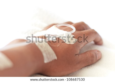 closeup shot of a patient's hand with saline intravenous (iv)