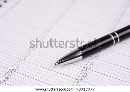 closeup shot of a pen on a calendar page
