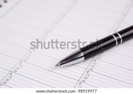 closeup shot of a pen on a calendar page