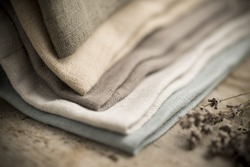 Closeup shot of a pile of folded dull-colored cotton fabric.