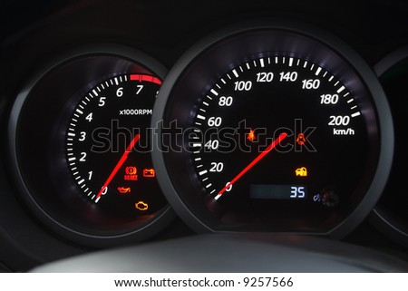 Closeup shot of a speedometer and tachometer of a modern car.