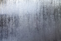 Closeup shot of a steamy window with water drops made in dull day.