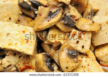 Closeup shot of bean curd delicacy cooked Asian style. Suitable for food and beverage, healthy lifestyle, and diet and nutrition.