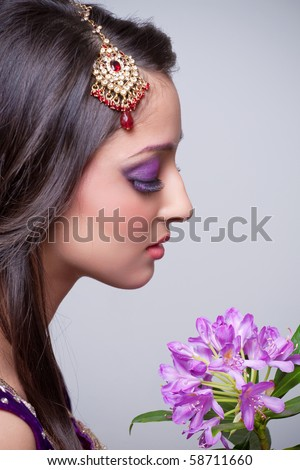 Closeup shot of beautiful asian bride with flowers