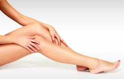 Closeup shot of beautiful female legs and hands. Hair removal concept