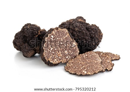 Closeup shot of black truffles and oak leaves isolated on white background. Сток-фото ©