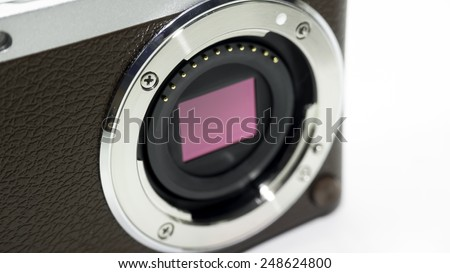 Closeup shot of camera image sensor (CCD or Cmos) for compact, APS-C, SLR or DSLR point and shoot camera. Isolated on white background. Copy space.