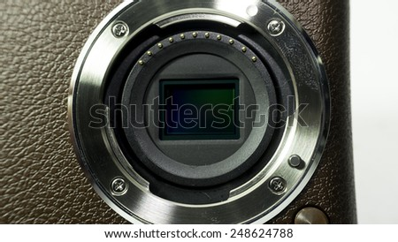 Closeup shot of camera sensor (CCD or Cmos) for compact, APS-C, SLR or DSLR point and shoot camera. Isolated on white background. Copy space.