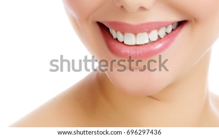 Closeup shot of cheerful smiling female with fresh clear skin, white background, isolated #696297436
