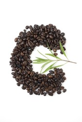 Closeup shot of coffee beans against white background with Tarragon herb
