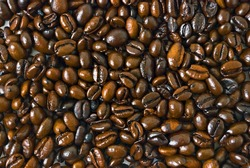 Closeup shot of coffee beans filling whole frame