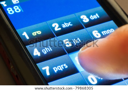 closeup shot of dialing on touxh screen smartphone - stock photo