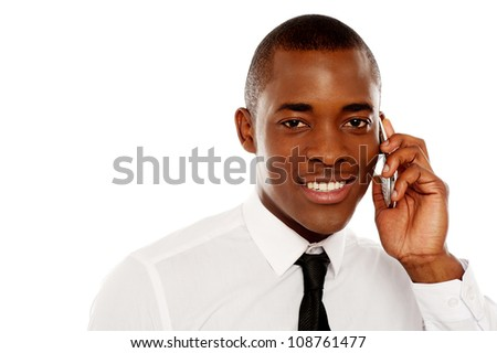 Closeup shot of executive communicating on cellphone against white background