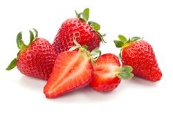 Closeup shot of fresh strawberries. Isolated on white background.