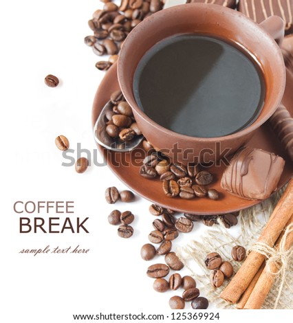 Closeup shot of freshly prepared cup of coffee with cinnamon, coffee beans, chocolate candy and cakes isolated on white background (with sample text)