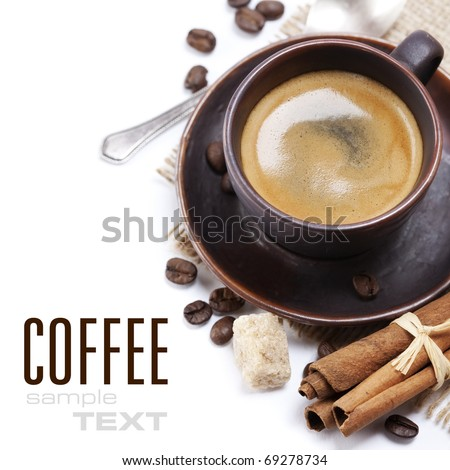 Closeup shot of freshly prepared cup of italian espresso with cinnamon, coffe beans, brown sugar and chocolate over white (with sample text)