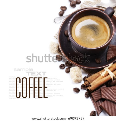 Closeup shot of freshly prepared cup of italian espresso with cinnamon, coffee beans, brown sugar and chocolate over white (with sample text)