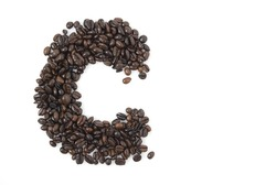 Closeup shot of letter C for coffee, shot against white background