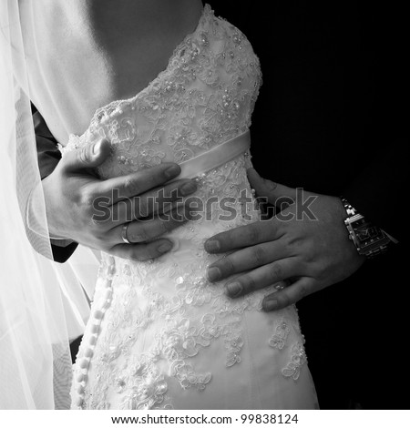 closeup shot of newlyweds hands - stock photo