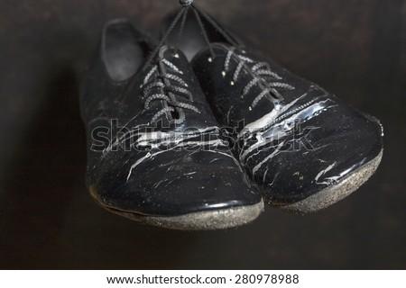 Closeup Shot of Pair of Worn-out Standard European Ballroom Dance Shoes. Against Black Background. Horizontal Image Orientation.