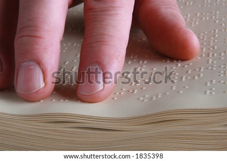 closeup shot of person reading Braille
