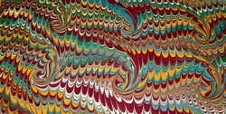 Closeup Shot of Pretty, Swirling Red, Yellow, Blue, Green and White Dye Blot Marbling Wave Pattern on Paper Inside of Antique Book