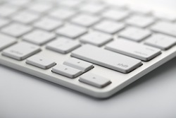 Closeup shot of white keyboard on white background.