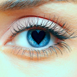 Closeup shot of woman eye with heart in the pupil