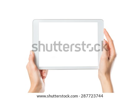 Closeup shot of woman hands holding digital tablet isolated on white background. Female hands holding a palmtop with white screen. Digital tablet with white display ready for your webpage or design. #287723744
